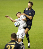 Jack Elliott, right, of the Philadelphia Union and Amar Sejdic of the Montreal Impact battle for the ball in the first half. The Philadelphia Union becomes the first Philadelphia-area team to allow fans in the stands for their game against Montreal Sunday, Oct. 11, 2020, in Chester, Pa. (Charles Fox/The Philadelphia Inquirer via AP)