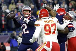 New England Patriots quarterback Tom Brady (12) passes under pressure from Kansas City Chiefs defensive end Alex Okafor (97) in the first half of an NFL football game, Sunday, Dec. 8, 2019, in Foxborough, Mass. (AP Photo/Steven Senne)