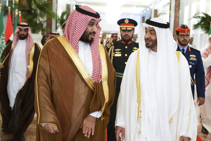 In this Wednesday, Nov. 27, 2019, photo released by Ministry of Presidential Affairs, Abu Dhabi Crown Prince Mohammed bin Zayed Al Nahyan, right, meets Saudi Crown Prince Mohammed bin Salman in Abu Dhabi, United Arab Emirates. Saudi crown prince is in the United Arab Emirates for talks that are expected to focus on the war in Yemen and tensions with Iran. (Hamad Al Kaabi/Ministry of Presidential Affairs via AP)