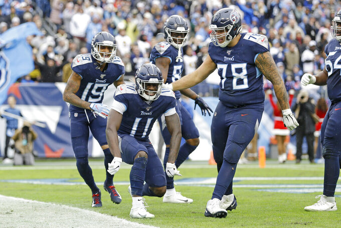 Tennessee Titans wide receiver A.J. Brown (11) celebrates after scoring a touchdown on a 49-yard run against the New Orleans Saints in the first half of an NFL football game Sunday, Dec. 22, 2019, in Nashville, Tenn. (AP Photo/James Kenney)
