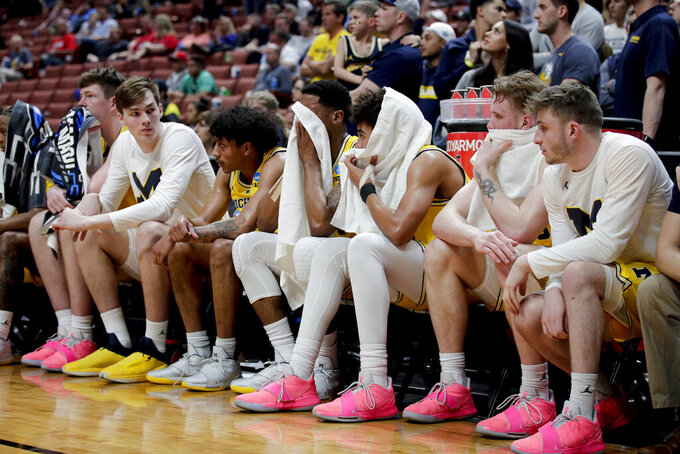 Michigan players watch from the bench during the second half against Texas Tech during an NCAA men's college basketball tournament West Region semifinal Thursday, March 28, 2019, in Anaheim, Calif. (AP Photo/Jae C. Hong)