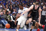 Memphis' guard Alex Lomax (2) and Cincinnati's center Chris Vogt (33) battle for a loose ball in the second half of an NCAA college basketball game Thursday, Jan. 16, 2020, in Memphis, Tenn. (AP Photo/Karen Pulfer Focht)