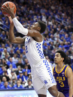 Kentucky's Ashton Hagans (2) shoots near LSU's Tremont Waters (3) during the second half of an NCAA college basketball game in Lexington, Ky., Tuesday, Feb. 12, 2019. LSU won 73-71. (AP Photo/James Crisp)