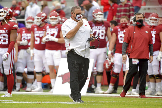 Arkansas head coach Sam Pittman walks on the field against LSU during the second half of an NCAA college football game Saturday, Nov. 21, 2020, in Fayetteville, Ark. (AP Photo/Michael Woods)