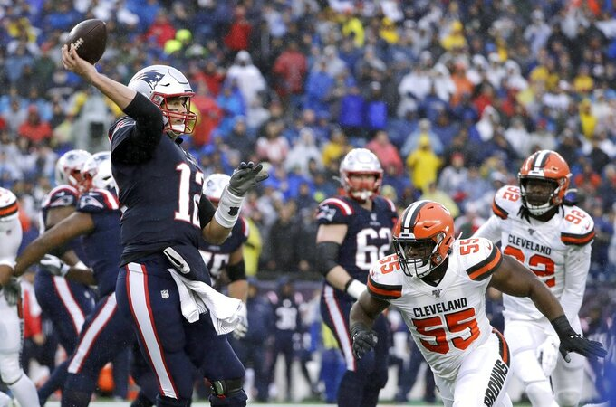 New England Patriots quarterback Tom Brady passes under pressure from Cleveland Browns linebacker Genard Avery (55) in the first half of an NFL football game, Sunday, Oct. 27, 2019, in Foxborough, Mass. (AP Photo/Steven Senne)