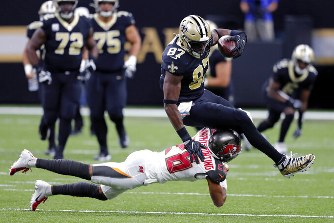 New Orleans Saints tight end Jared Cook (87) is tackled by Tampa Bay Buccaneers defensive back Sean Murphy-Bunting (26) in the first half of an NFL football game in New Orleans, Sunday, Oct. 6, 2019. (AP Photo/Bill Feig)