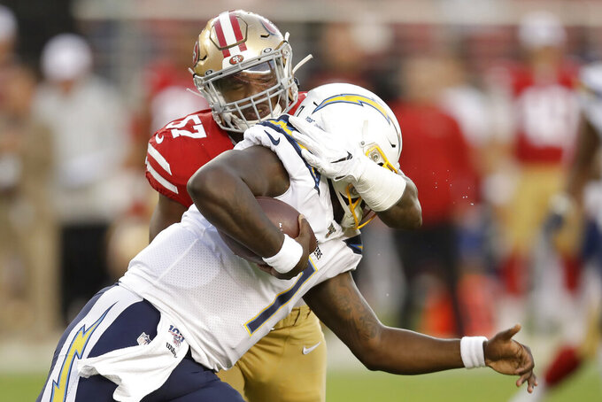 San Francisco 49ers linebacker Dre Greenlaw, rear, tackles Los Angeles Chargers quarterback Cardale Jones during the first half of an NFL preseason football game in Santa Clara, Calif., Thursday, Aug. 29, 2019. (AP Photo/Ben Margot)