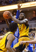 Missouri's Jeremiah Tilmon, right, shoots past Kentucky's PJ Washington, rear, during the first half of an NCAA college basketball game Tuesday, Feb. 19, 2019, in Columbia, Mo. (AP Photo/L.G. Patterson)