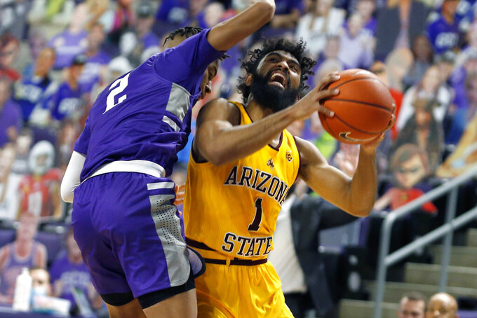 CORRECTS MONTH TO DEC. NOT JAN. - Arizona State guard Remy Martin (1) is fouled by Grand Canyon's Chance McMillian (2) as he drives to the basket during the first half of an NCAA college basketball game, Sunday, Dec. 13, 2020, in Phoenix. (AP Photo/Ralph Freso)