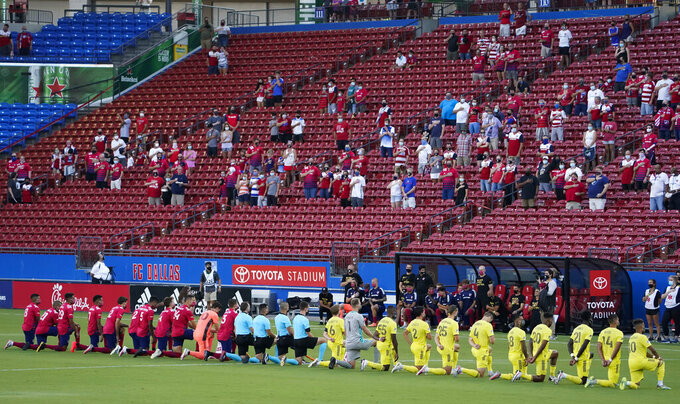 FC Dallas (left) and Nashville SC players kneel during the national anthem before an MLS soccer game at Toyota Stadium on Wednesday, Aug. 12, 2020, in Frisco, Texas. (Smiley N. Pool/The Dallas Morning News via AP)