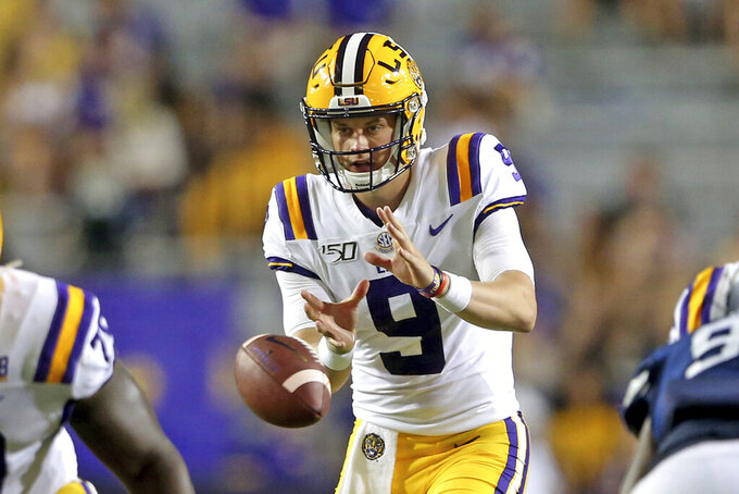 LSU quarterback Joe Burrow (9) takes a snap during the third quarter of the team's NCAA football game against Georgia Southern in Baton Rouge, La., Saturday, Aug. 31, 2019. Burrow tied an LSU single-game record with five touchdown passes before halftime. (AP Photo/Michael Democker)