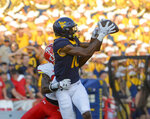 West Virginia's Sean Ryan catches a pass during the fourth quarter of an NCAA college football game against Maryland Saturday, Sept. 4, 2021 in College Park, Md. (Kevin Richardson/The Baltimore Sun via AP)