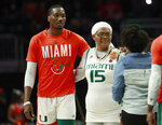 Miami center Ebuka Izundu and his mother Ifeoma are introduced before the start of an NCAA college basketball game against Pittsburgh, Tuesday, March 5, 2019, in Coral Gables, Fla. Ebuka Izundu is visiting from Nigeria and will get to see her son play in a basketball game for the first time. (AP Photo/Wilfredo Lee)