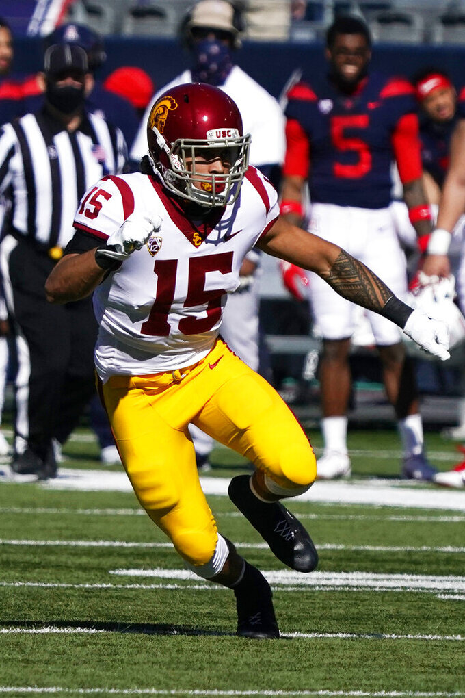 FILE - In this Nov. 14, 2020, file photo, Southern California safety Talanoa Hufanga (15) chases a play in the second half of an NCAA college football game against Arizona in Tucson, Ariz. Hufanga was selected as the PAC-12 defensive player of the year.  (AP Photo/Rick Scuteri, File)