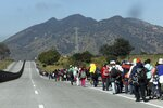 Central American migrants travel as a caravan toward the U.S. border on the highway that connects Guadalajara with Tepic, Mexico, Tuesday, Nov. 13, 2018. Many migrants say they are fleeing rampant poverty, gang violence and political instability primarily in the Central American countries of Honduras, Guatemala, El Salvador and Nicaragua. (AP Photo/Rodrigo Abd)