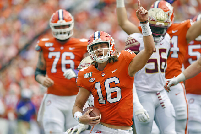 FILE - In this Oct. 12, 2019, filer photo, Clemson quarterback Trevor Lawrence (16) reacts after scoring a touchdown during the first half of an NCAA college football game against Florida State, in Clemson, S.C. Clemson is preseason No. 1 in The Associated Press Top 25, Monday, Aug. 24, 2020.(AP Photo/Richard Shiro, File)