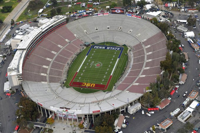 FILE - This Jan. 2, 2017, file pool photo, shows an aerial view of the empty Rose Bowl stadium before to the Rose Bowl NCAA college football game between Southern California and Penn State in Pasadena, Calif. No spectators will be allowed at the Rose Bowl for the College Football Playoff semifinal on Jan. 1 because of COVID-19 restrictions imposed by the state, county and city of Pasadena, The Tournament of Roses said Thursday, Dec. 3, 2020. (The Tournament of Roses via AP, Pool, File)