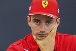Ferrari driver Charles Leclerc of Monaco listens to a reporter's questions during a press conference for the Japanese Formula One Grand Prix at Suzuka Circuit in Suzuka, Thursday, Oct. 10, 2019. (AP Photo/Toru Hanai)