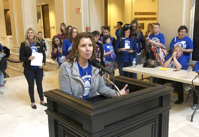 In this March 11, 2019, photo, Epic Charter Schools administrator Erin Barnes speaks during Virtual Charter School Day at the state Capitol in Oklahoma City. Oklahoma investigators allege the founders of Epic, Oklahoma's largest virtual charter school, embezzled millions of dollars in state funds through an illegal scheme involving the use of