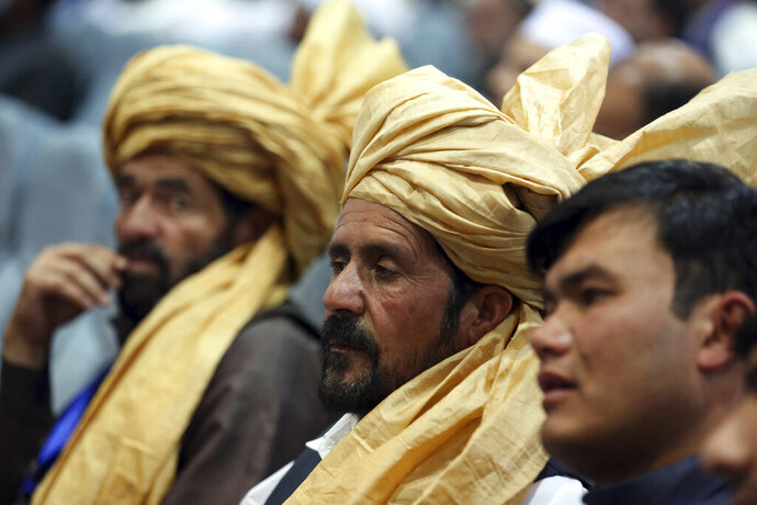 Delegates attend the fourth day of the Afghan Loya Jirga meeting in Kabul, Afghanistan, Thursday, May 2, 2019. The Afghan grand council has come up with a series of recommendations for peace talks with the Taliban after four days of meetings in Kabul. President Ashraf Ghani convened the council of more than 3,200 participants, known as Loya Jirga, to hammer out a common strategy. (AP Photo/Rahmat Gul)