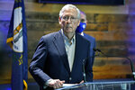 FILE - In this April 5, 2021, file photo Senate Minority Leader Mitch McConnell, R-Ky., listens to a reporter's question during a news conference at a COVID-19 vaccination site in Lexington, Ky.  For decades the GOP and business have shared common ground, especially with their mutual belief in low taxes and the need to repeal regulations. But the relationship has come under increasing pressure as companies take cultural stands and other interests diverge. (AP Photo/Timothy D. Easley, File)