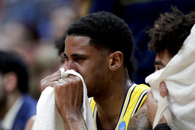 Michigan guard Charles Matthews sits on the bench during the team's loss to Texas Tech during an NCAA men's college basketball tournament West Region semifinal Thursday, March 28, 2019, in Anaheim, Calif. (AP Photo/Jae C. Hong)