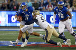 Tulsa quarterback Zack Smith (11) is taken down by Navy's Tama Tuitele during an NCAA college football game, Saturday, Oct. 12, 2019, in Tulsa, Okla. (Stephen Pingry/Tulsa World via AP)