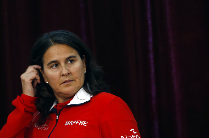FILE - In this Thursday, April 6, 2017 file photo, Spain team captain Conchita Martinez at a press conference after the draw for the tennis Davis Cup quarterfinal match in Belgrade, Serbia. Former Wimbledon champion Martinez said Saturday, Feb. 27, 2021 that she has tested positive for the coronavirus. In a statement posted on social media she said she is in quarantine at a hospital in Doha after she tested positive on arrival in the United Arab Emirates. (AP Photo/Darko Vojinovic, File)