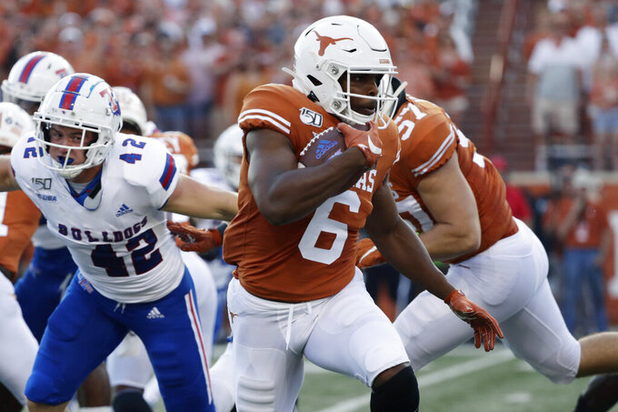 FILE - In this Saturday, Aug. 31, 2019 file photo, Texas wide receiver Devin Duvernay (6) during the first half of an NCAA college football game against Louisiana Tech in Austin, Texas. Texas senior wide receiver Devin Duvernay is having his best year after a position change has made him quarterback Sam Ehlinger's top target. Duvernay has 45 catches this season and his nine per game is best in the nation heading into No. 11 Texas' Saturday, Oct. 12, 2019 matchup against No. 6 Oklahoma. (AP Photo/Eric Gay, File)