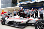 Will Power, of Australia, exits his car after he finished first in qualifying for the IndyCar Classic auto race, Saturday, March 23, 2019, in Austin, Texas. (AP Photo/Eric Gay)
