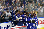 The Tampa Bay Lightning celebrate their series win over the Montreal Canadiens to clinch the Stanley Cup in Game 5 of the NHL hockey finals, Wednesday, July 7, 2021, in Tampa, Fla. (AP Photo/Gerry Broome)