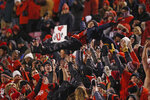 FILE - Utah fans celebrate after scoring against Colorado in the second half during an NCAA college football game Saturday, Nov. 30, 2019, in Salt Lake City. What is most commonly referred to as major college football (aka NCAA Division I Bowl Subdivision or FBS) is compromised of 130 teams and 10 conferences. Seventy-seven of those teams are scheduled to play throughout the fall, starting at various times in September. The other 53, including the entire Big Ten and Pac-12, have postponed their seasons and are hoping to make them up later. That means no No. 2 Ohio State, No. 7 Penn State, No. 9 Oregon and six other teams that were ranked in the preseason AP Top 25.(AP Photo/Rick Bowmer, File)