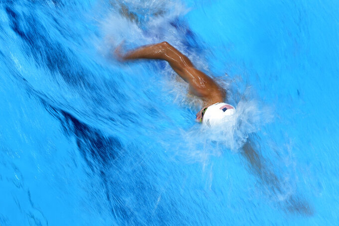 Robert Finke, of the United States, swims to a second place finish in heat 4 of the men's 1500-meter freestyle at the 2020 Summer Olympics, Friday, July 30, 2021, in Tokyo, Japan. (AP Photo/Jeff Roberson)