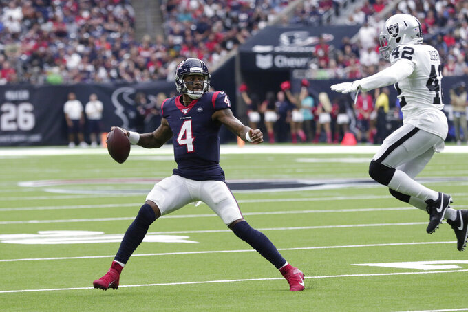 Houston Texans quarterback Deshaun Watson (4) is pressured by Oakland Raiders free safety Karl Joseph (42) during the first half of an NFL football game Sunday, Oct. 27, 2019, in Houston. (AP Photo/Michael Wyke)