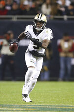 New Orleans Saints quarterback Teddy Bridgewater (5) scrambles with the ball in an NFL game against the Chicago Bears, Sunday, Oct. 20, 2019 in Chicago. (Margaret Bowles via AP)