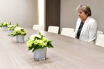 In this Friday, Oct. 20, 2017 file photo, British Prime Minister Theresa May waits for the arrival of European Council President Donald Tusk prior to a bilateral meeting at an EU summit in Brussels. As May announced her departure with a Brexit plan nowhere near success, European Union leaders offered kind words. But it was quite another matter during the years of negotiations with the bloc that often produced exasperation, miscommunication and even some ridicule of her. (AP Photo/Geert Vanden Wijngaert, Pool, File)