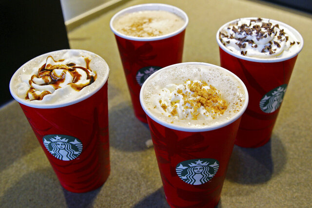 FILE - This Monday, Nov. 24, 2014 file photo shows four holiday Starbucks coffee drinks, clockwise from left, the Gingerbread Latte, the Eggnog Latte, the Peppermint Mocha, and the new Chestnut Praline Latte, at a store in Seattle. On Friday, Dec. 20, 2019, The Associated Press reported on stories circulating online incorrectly asserting that the manager of a Starbucks in North Carolina informed his employees they would be fired on the spot for saying