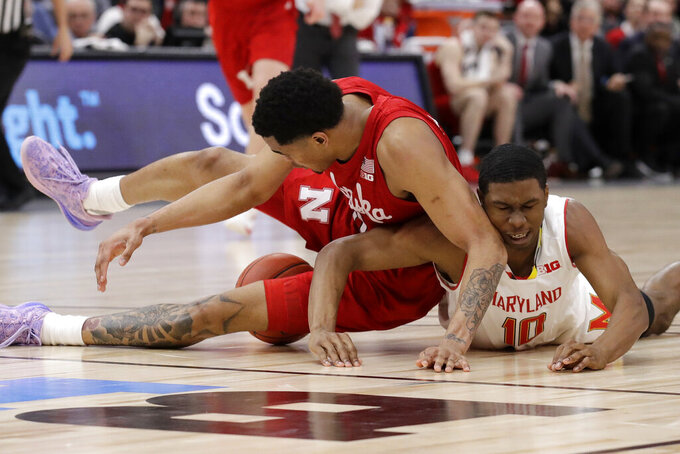Nebraska's James Palmer Jr. and Maryland's Serrel Smith Jr. (10) battle for a loose ball during the second half of an NCAA college basketball game in the second round of the Big Ten Conference tournament, Thursday, March 14, 2019, in Chicago. The Nebraska won 69-61. (AP Photo/Nam Y. Huh)