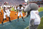 Alabama linebackers Quandarrius Robinson, left, and Keanu Koht (19) celebrate with the school mascot after Big Al after defeating Florida in an NCAA college football game, Saturday, Sept. 18, 2021, in Gainesville, Fla. (AP Photo/John Raoux)