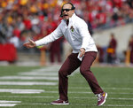 FILE - In this Saturday, Oct. 13, 2018, file photo, Minnesota head coach P.J. Fleck shouts to his team during the first half of an NCAA college football game against Ohio State in Columbus, Ohio. If Nebraska needs any extra incentive to pick up its elusive first win Saturday, players who were on the field against Minnesota last year need only remember what happened in that game. (AP Photo/Jay LaPrete, File)