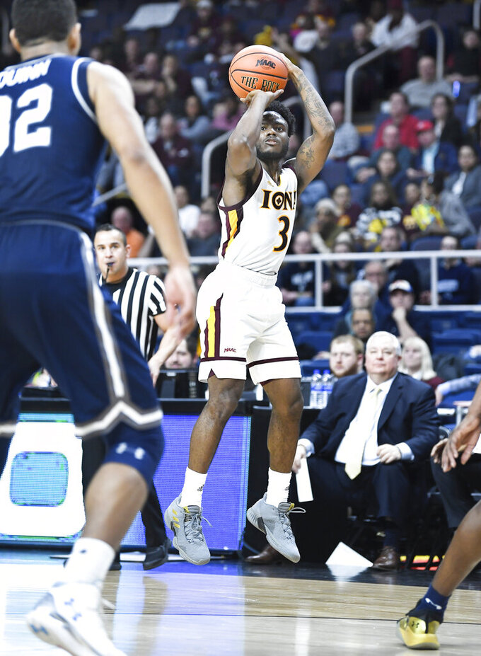 Iona guard Asante Gist (3) scores against Monmouth during the first half of the championship NCAA college basketball game during the Metro Atlantic Athletic Conference tournament, Monday, March 11, 2019, in Albany, N.Y. (AP Photo/Hans Pennink)