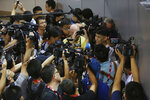 FILE - In this Oct. 10, 2015, file photo, NBA basketball player Jeremy Lin of the Charlotte Hornets talks to media after a training session for the 2015 NBA Global Games in Shenzhen, China. As sports prepare to resume, journalists are facing the same reckoning that their colleagues who cover politics, education and entertainment have encountered — coming up with new approaches to coverage with reduced access and resources. Professional leagues closed media access to locker rooms and clubhouses in early March. (AP Photo/Kin Cheung, File)
