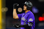 Colorado Rockies' Colton Welker reacts after hitting an RBI-single off Philadelphia Phillies pitcher Ranger Suarez during the fourth inning of a baseball game, Thursday, Sept. 9, 2021, in Philadelphia. (AP Photo/Matt Slocum)