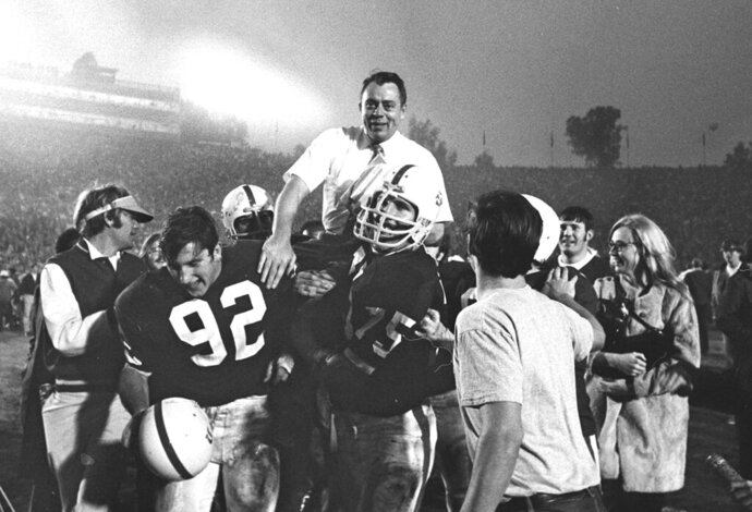 FILE - In this In this Jan. 1, 1971, file photo, Stanford coach John Ralston is carried off the field by his players after they defeated the Ohio State Buckeyes in the NCAA college football Rose Bowl game in Pasadena, Calif. Ralston, the former Stanford and Denver Broncos coach, died Saturday, Sept. 14, 2019, in Sunnyvale, Calif. He was 92. (AP Photo/File)