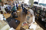 In this Thursday, June 25, 2020, photo, workers fill customers' orders in Parnassus Books in Nashville, Tenn. The independent bookstore, owned by novelist Ann Patchett and Karen Hayes, opened and thrived while others were closing their doors and is once again defying the odds during the coronavirus pandemic. (AP Photo/Mark Humphrey)