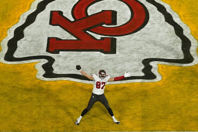 Tampa Bay Buccaneers' Rob Gronkowski (87) reacts after scoring a touchdown during the first half of the NFL Super Bowl 55 football game against the Kansas City Chiefs Sunday, Feb. 7, 2021, in Tampa, Fla. (AP Photo/Charlie Riedel)