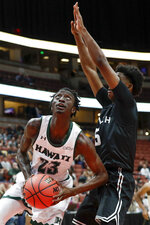 Hawaii guard Sheriff Drammeh, left, looks to score past Long Beach State forward Mason Riggins during first half of an NCAA college basketball game at the Big West men's tournament in Anaheim, Calif., Thursday, March 14, 2019. (AP Photo/Chris Carlson)