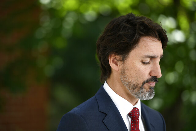 Prime Minister Justin Trudeau speaks during a news conference on the COVID-19 pandemic outside his residence at Rideau Cottage in Ottawa, Thursday, June 18, 2020. (Justin Tang/The Canadian Press via AP)