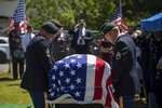 Military personnel carry the remains of Army Sgt. 1st Class Elliott Robbins to his final resting place at Ben Lomond Cemetery on Thursday, July 18, 2019. Robbins died in a non-combat incident on June 30 while serving in Afghanistan.   (Ben Dorger/Standard-Examiner via AP)
