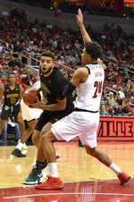 Vermont forward Anthony Lamb (3) attempts to drive around Louisville forward Dwayne Sutton (24) during the first half of an NCAA college basketball game, in Louisville, Ky., Friday, Nov. 16, 2018. (AP Photo/Timothy D. Easley)